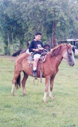 Roberto F. R. Beltran learning to ride a horse.