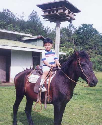 Rollyboy Beltran learning to ride a horse.